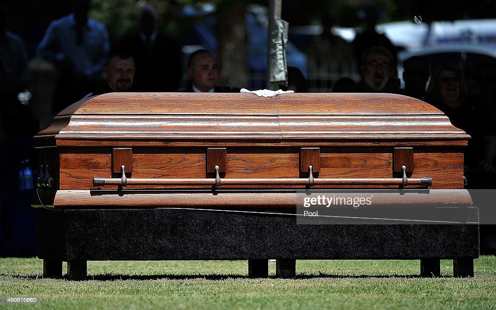 A pair of white gloves rest atop the casket of Las Vegas Metropolitan Police Department Officer Igor Soldo during funeral services for him at Palm...