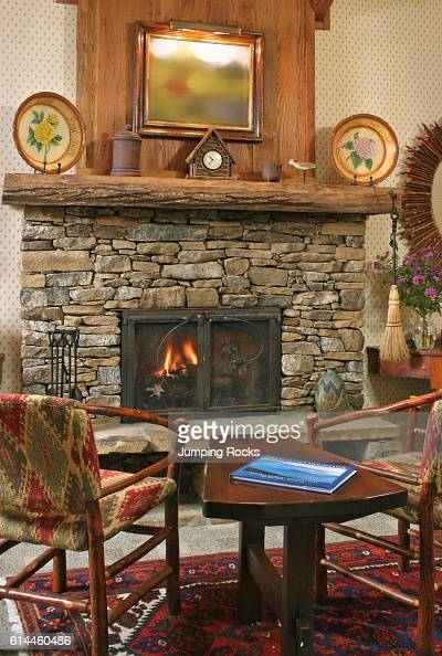 Stone mantle with chairs pictures getty images