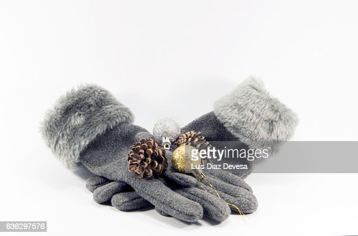 A pair of woollen gloves and christmas decoration