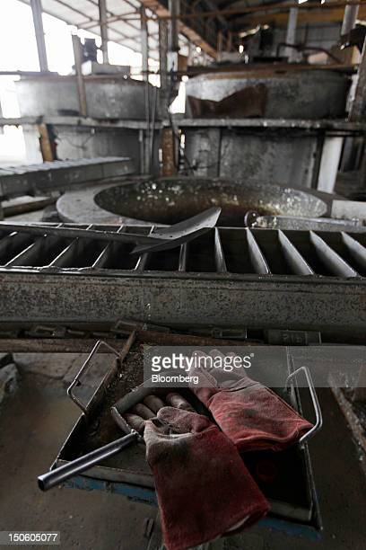 A pair of workers' gloves lay on top of tools in a tin smelter owned by Johan Murod a private tin refiner in Pangkal Pinang Bangka Island Indonesia...