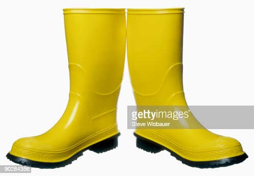 Pair Of Yellow Rubber Muck Boots Stock Photo | Getty Images