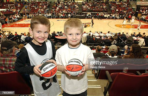 A pair of young Idaho Stampede fans display their autographed Spalding mini basketballs during the 2008 NBA Development League Showcase game against...
