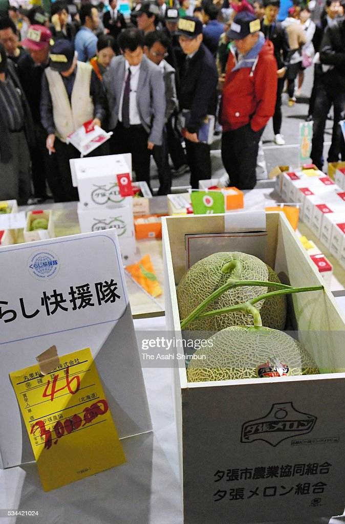 A pair of Yubari melons fetch 3 million yen (27,360 U.S. dollars) during the first auction of the season at the Sapporo Central Wholesale Market on May 26, 2016 in Sapporo, Hokkaido, Japan. The winning bid smashed the previous record of 2.5 million yen, forked out in both 2008 and 2014.