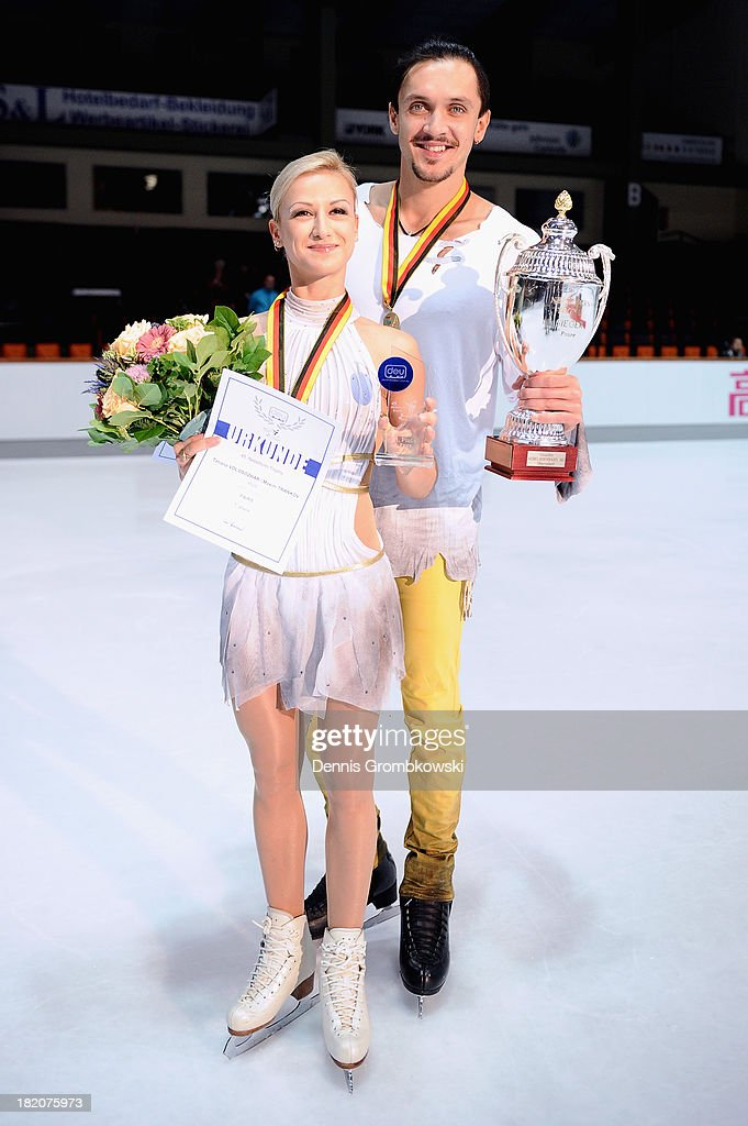Pair skaters <a gi-track='captionPersonalityLinkClicked' href=/galleries/search?phrase=Tatiana+Volosozhar&family=editorial&specificpeople=798077 ng-click='$event.stopPropagation()'>Tatiana Volosozhar</a> and <a gi-track='captionPersonalityLinkClicked' href=/galleries/search?phrase=Maxim+Trankov&family=editorial&specificpeople=798054 ng-click='$event.stopPropagation()'>Maxim Trankov</a> of Russia pose during day two of the ISU Nebelhorn Trophy at Eissportzentrum Oberstdorf on September 27, 2013 in Oberstdorf, Germany.