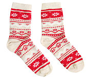 Pair socks with red winter holiday ornaments isolated.