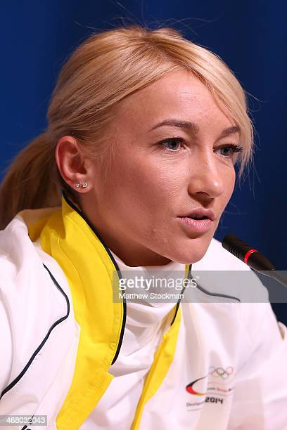 Pairs ice skater Aljona Savchenko of Germany attends a Team Germany press conference during Day 2 of the Sochi 2014 Winter Olympics at the Main Press...