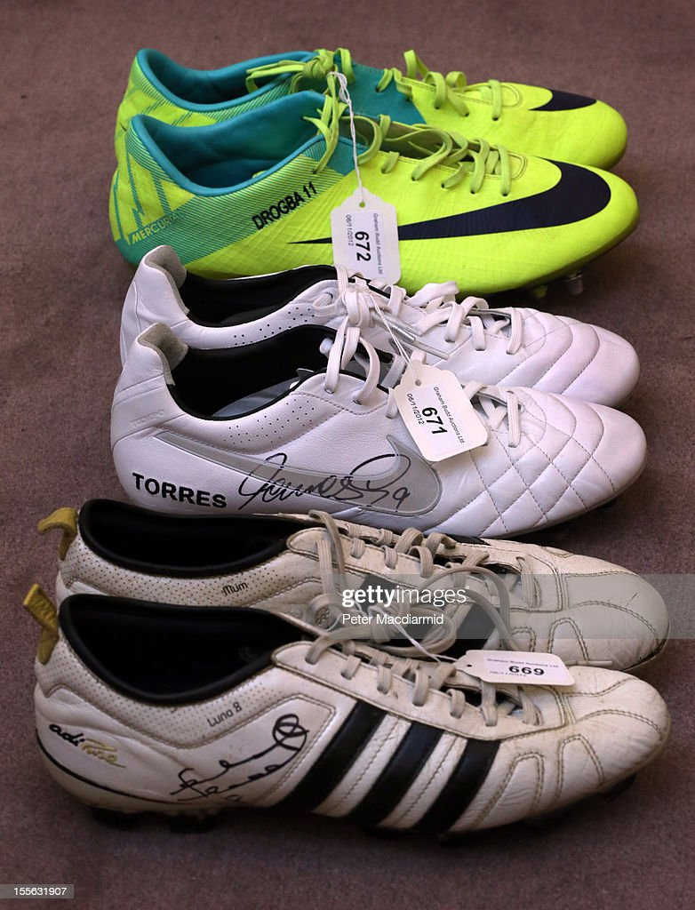 Pairs of football boots worn by (top to bottom) Didier Drogba, Fernando Torres and Frank Lampard are shown at Sotheby's on November 6, 2012 in London, England. Graham Budd auctioneers are holding a two day sale of Sporting Memorabilia at Sotheby's in London on 5-6th November 2012.