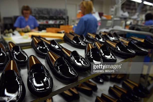 Pairs of mocasins are displayed in the protopypes workshop of the Italian shoes and luxury leather goods Tod's on May 27 2013 in Casete d'Ete in the...