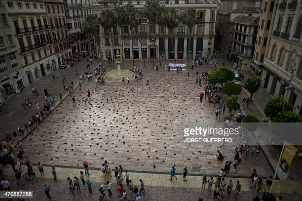745 pairs of red shoes lie at the Constitucion square in Malaga where the Mexican artist Elina Chauvet's artinstallation 'Zapatos Rojos' is displayed...