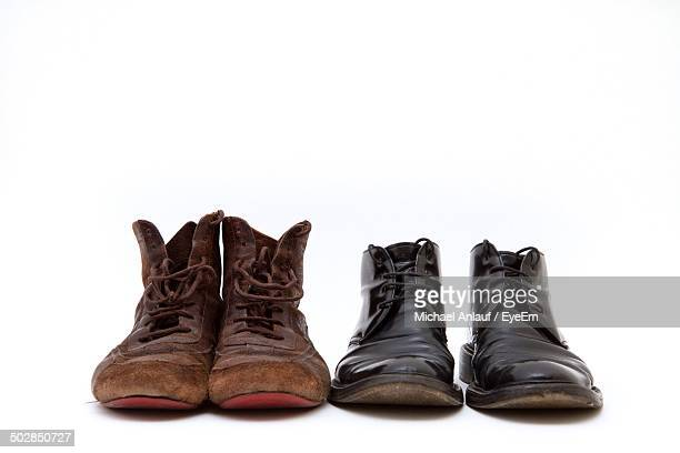 Pairs of shoes over white background