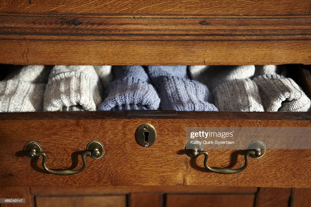 Pairs of wool socks in open drawer