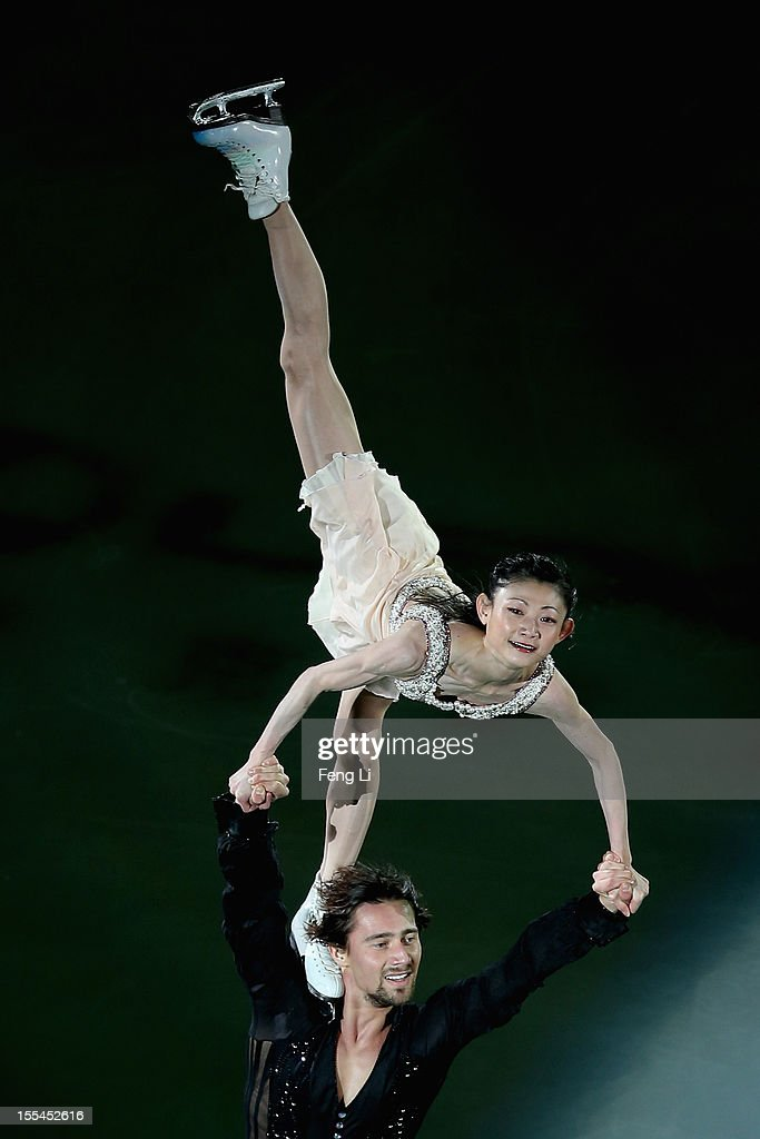 Pairs silver medalists Yuko Kavaguti and <a gi-track='captionPersonalityLinkClicked' href=/galleries/search?phrase=Alexander+Smirnov&family=editorial&specificpeople=4045603 ng-click='$event.stopPropagation()'>Alexander Smirnov</a> of Russia perform during Cup of China ISU Grand Prix of Figure Skating 2012 at the Oriental Sports Center on November 4, 2012 in Shanghai, China.