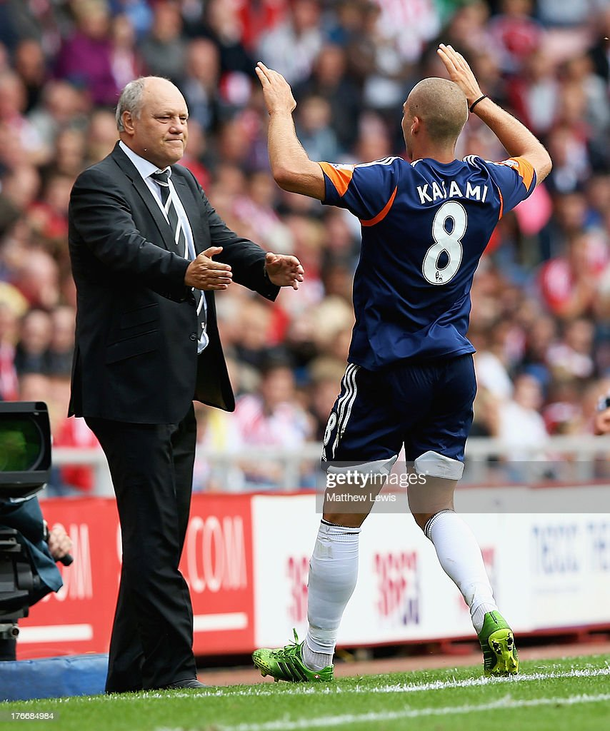 <a gi-track='captionPersonalityLinkClicked' href=/galleries/search?phrase=Pajtim+Kasami&family=editorial&specificpeople=6392616 ng-click='$event.stopPropagation()'>Pajtim Kasami</a> of Fulham celebrates his goal with manager <a gi-track='captionPersonalityLinkClicked' href=/galleries/search?phrase=Martin+Jol&family=editorial&specificpeople=215368 ng-click='$event.stopPropagation()'>Martin Jol</a> during the Barclays Premier League match between Sunderland and Fulham at the Stadium of Light on August 17, 2013 in Sunderland, England.