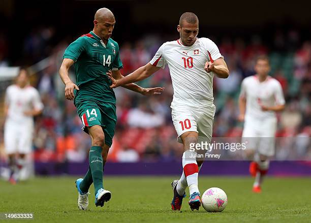 Pajtim Kasami of Switzerland battles with Jorge Enriquez of Mexico during the Men's Football first round Group B match between Mexico and Switzerland...