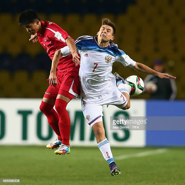 Pak Yong Gwan of Korea DPR is challenged by Dmitrii Pletnev of Russia during the FIFA U17 World Cup Chile 2015 Group E match between Korea DPR and...