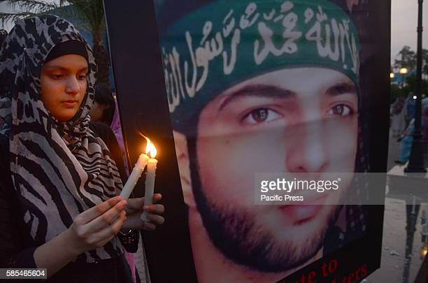 Pakistan activist from different civil society holding the placards while participate in candle light vigil to show solidarity with Kashmiri people...