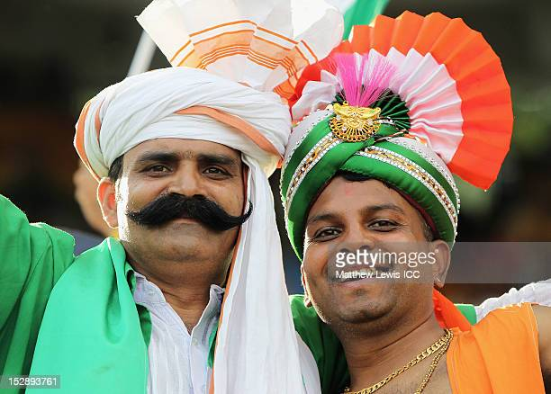 Pakistan and an Indian cricket fan look on during the ICC World Twenty20 2012 Super Eights Group 2 match between Pakistan and South Africa at R...