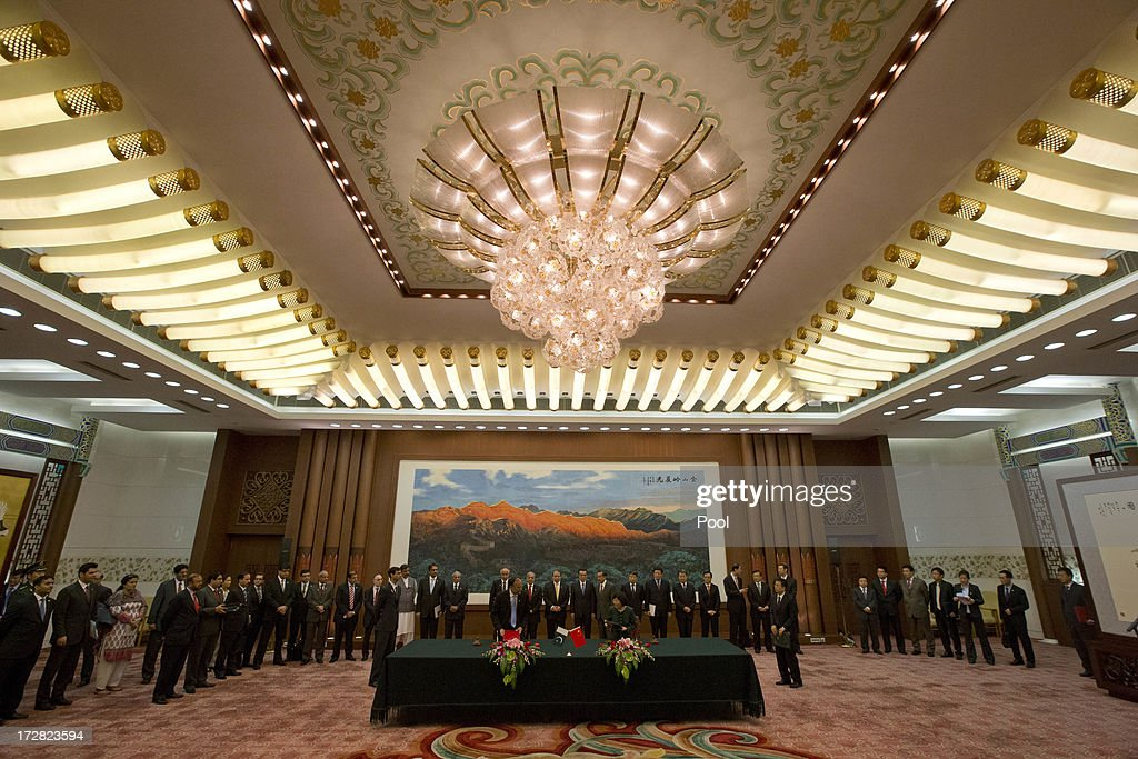 Pakistan and Chinese officials attend a signing ceremony held at the Great Hall of the People on July 5, 2013 in Beijing, China, Friday. This is Sharif's first foreign visit since returning to power and he is in China to negotiate investment to help his country's own failing economy, however trade between the two countries reached an all time high last year when it exceeded 12 billion USD.