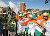 Pakistan and India supporters pose with their flags outside of the ground during the 2015 ICC Cricket World Cup match between India and Pakistan at...
