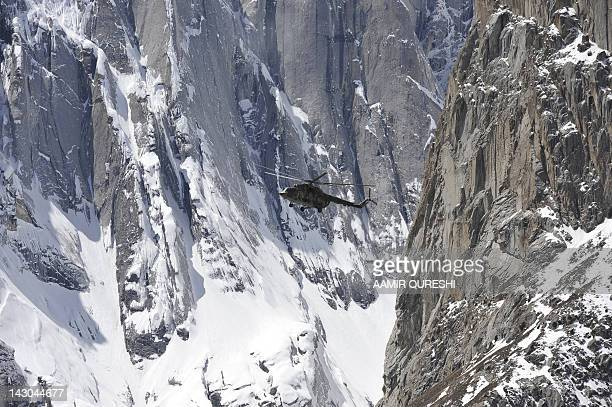 A Pakistan Army helicopter carrying President Asif Ali Zardari Army Chief General Ashfaq Kayani and other officials fly over the site of an avalanche...