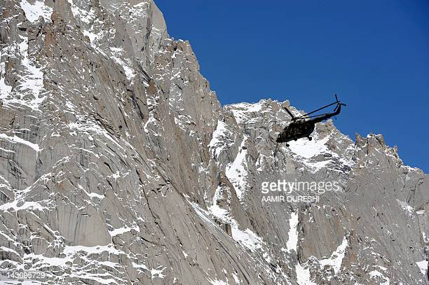 A Pakistan Army helicopter carrying President Asif Ali Zardari Army Chief General Ashfaq Kayani and other officials flies over the site of an...