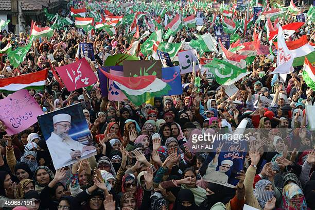 Pakistan Awami Tehreek activists wave flags during a protest rally in Lahore on December 29 2013 Hundreds of workers gathered on the call of Islamic...