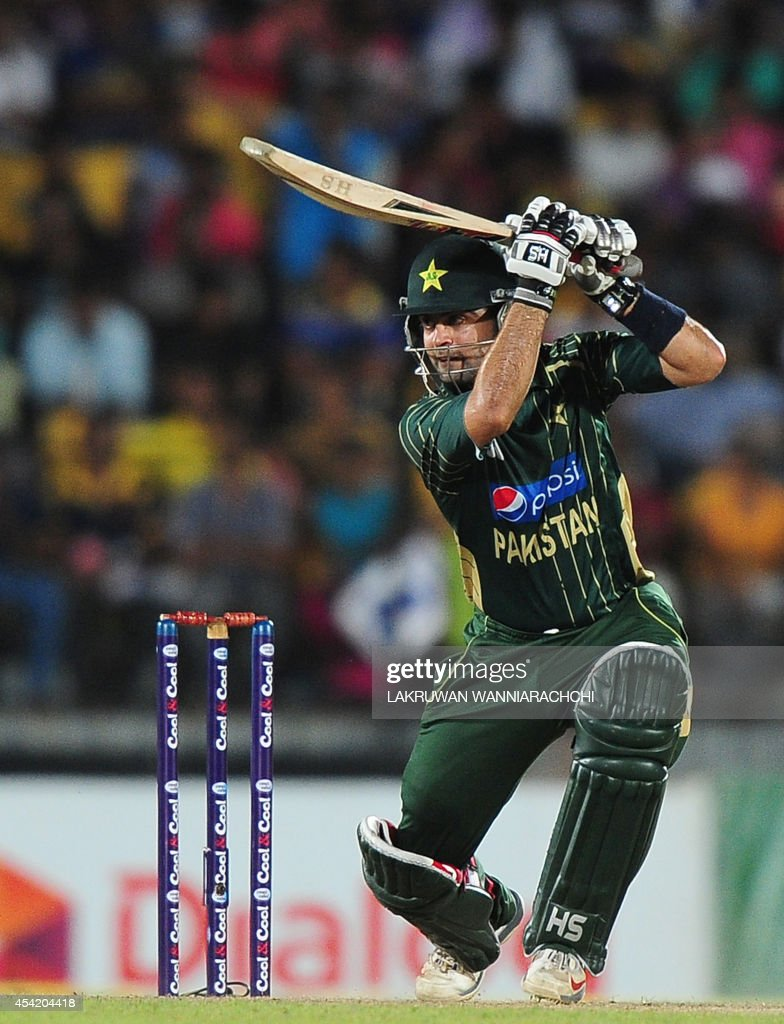 Pakistan batsman Ahmed Shehzad plays a shot during the second One Day International (ODI) match between Sri Lanka and Pakistan at the Suriyawewa Mahinda Rajapakse International Cricket Stadium in the southern district of Hambantota on August 26, 2014.
