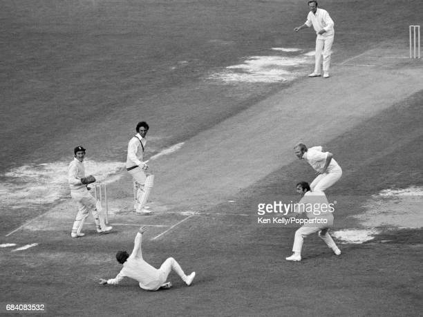 Pakistan batsman Asif Iqbal survives a chance as England captain Mike Denness fields the ball during the 2nd Test match between England and Pakistan...