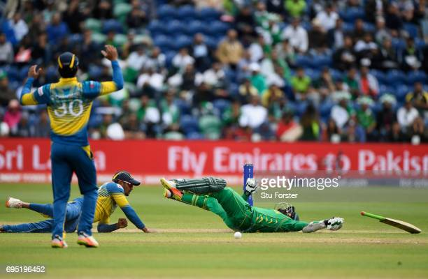 Pakistan batsman Azhar Ali clashes with Dhanushka Gunathilleke of Sri Lanka whilst going for a quick single during the ICC Champions League match...