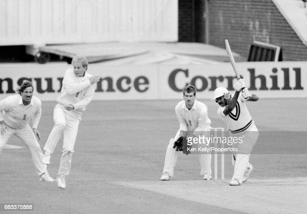 Pakistan batsman Javed Miandad drives the ball through the offside prompting England fielder David Gower to take evasive action during the 1st Test...