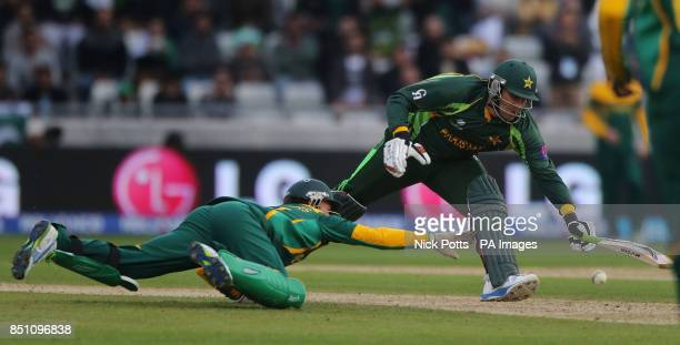 Pakistan batsman Misbah is almost run out by South Africa wicketkeeper AB de Villiers during the ICC Champions Trophy match at Edgbaston Birmingham