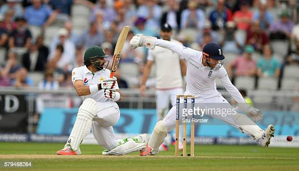 Pakistan batsman MisbahulHaq hits out watched by Jonny Bairstow during day three of the 2nd Investec Test match between England and Pakistan at Old...
