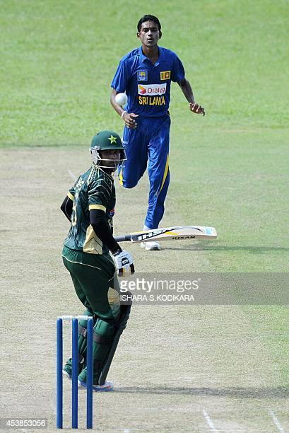 Pakistan batsman Mohammad Hafeez plays a shot during a warmup one day match against a Sri Lankan XI in Colombo on August 20 2014 Pakistan and Sri...