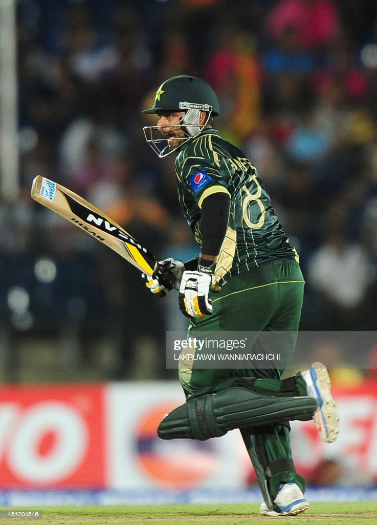 Pakistan batsman Mohammad Hafeez runs between the wickets during the second One Day International (ODI) match between Sri Lanka and Pakistan at the Suriyawewa Mahinda Rajapakse International Cricket Stadium in the southern district of Hambantota on August 26, 2014.