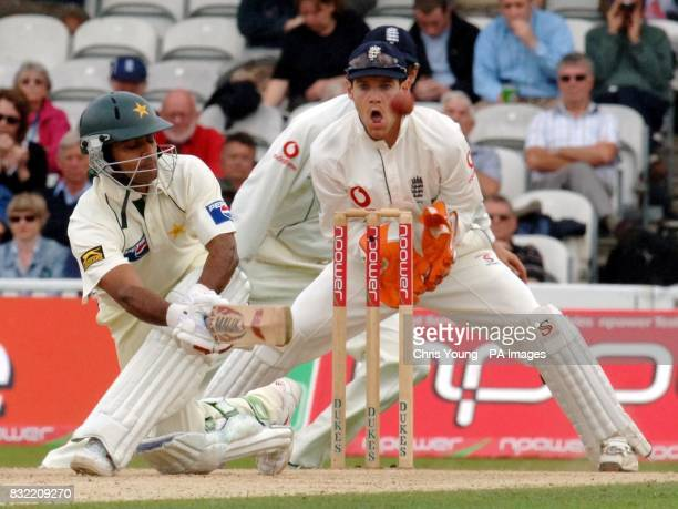 Pakistan batsman Mohammad Hafeez sweeps away a ball as England Wicket keeper Chris Read looks on during the second day of the fourth NPower test...