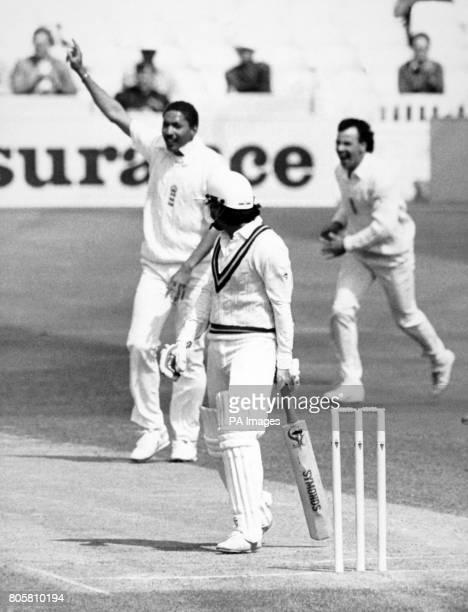 Pakistan batsman Ramiz Raja walks back to the Pavilion as England bowler Phil DeFreitas holds up his hand and John Emburey runs to celebrate