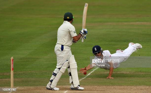 Pakistan batsman Saeed Ajmal looks on as England fielder Alastair Cook just fails to take a catch during day three of the 2nd npower test match...