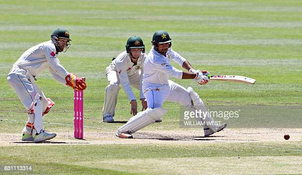 Pakistan batsman Sarfraz Ahmed cuts a ball away as Australia's Matthew Wade and Peter Handscomb look on on the final day of the third cricket Test...