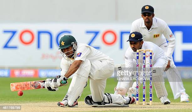 Pakistan batsman Sarfraz Ahmed plays a shot as Sri Lankan wicketkeeper Prasanna Jayawardene looks during the fourth day of the second cricket Test...