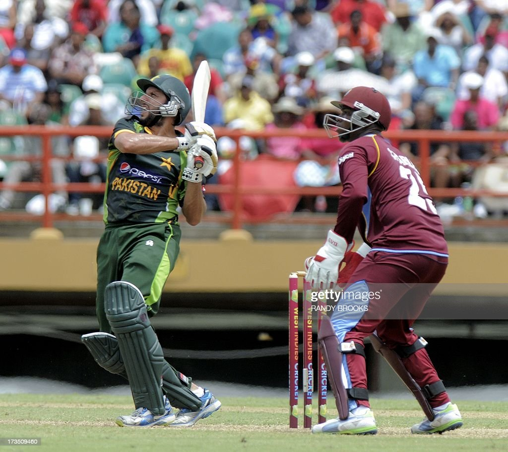 Pakistan batsman Shahid Afridi pulls West indies bowler Marlon Samuels during the 1st ODI West Indies v Pakistan at Guyana National Stadium on July 14, 2013. Pakistan crushed West Indies by 126 runs in the first one-day international. AFP PHOTO/Randy Brooks
