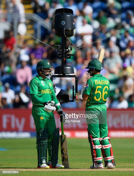 Pakistan batsmen Azhar Ali and Babar Azam chat whilst under the eye of Spider Cam during the ICC Champions Trophy semi final between England and...