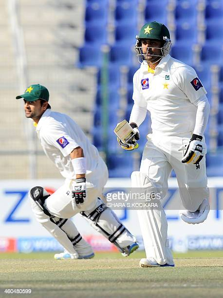Pakistan batsmen Mohammad Hafeez and Ahmed Shehzad run between the wickets during the final day of the first cricket Test match between Pakistan and...