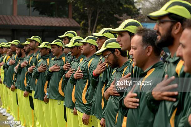 Pakistan blind cricketers listen to their national anthem before the start of a match between the Pakistan and Indian blind cricket teams at the...