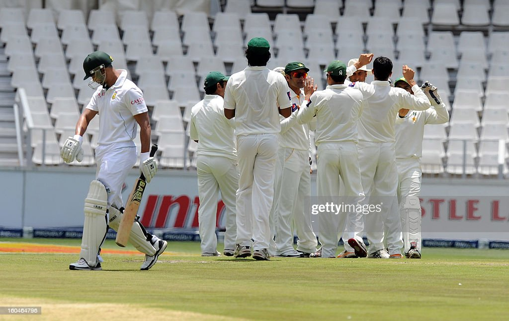 Pakistan bowler Junaid Khan celebrates with teammates the wicket of South African batsman Alviro Petersen on February 1, 2013 during the first Test against South Africa at Wanderers Stadium in Johannesburg.