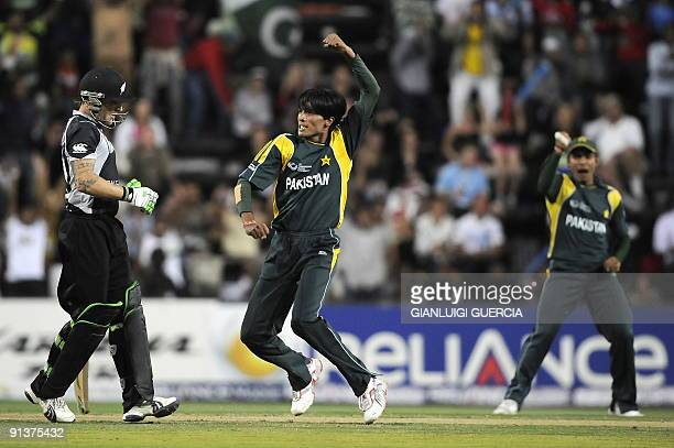 Pakistan bowler Mohammad Aamir celebrates after taking the wicket of New Zealand batsman Brendon McCullum on October 03 2009 during the ICC Champions...