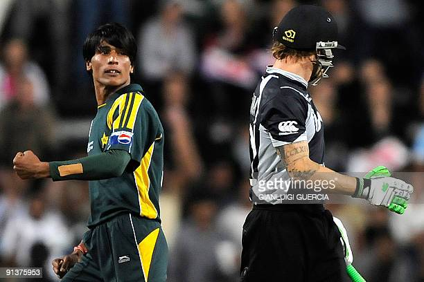 VERSION Pakistan bowler Mohammad Aamir celebrates after taking the wicket of New Zealand batsman Brendon McCullum on October 3 2009 during the ICC...