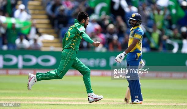 Pakistan bowler Mohammad Amir celebrates after dismissing Niroshan Dickwella of Sri Lanka during the ICC Champions League match between Sri Lanka and...
