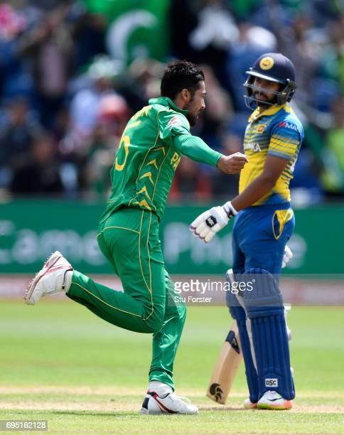 Pakistan bowler Mohammad Amir celebrates after dismissing Niroshan Dickwella of Sri Lanka during the ICC Champions League match between Sri Lanka and...