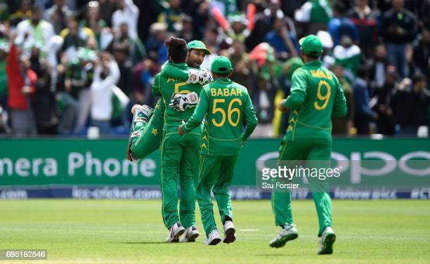 Pakistan bowler Mohammad Amir celebrates with wicketkeeper Sarfraz Ahmed after dismissing Niroshan Dickwella of Sri Lanka during the ICC Champions...