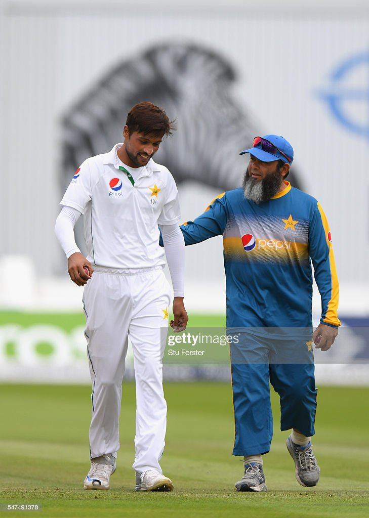 Pakistan bowler Mohammad Amir is encouraged by coach Mushtaq Ahmed before commencing his first bowleing spell during day two of the 1st Investec Test...